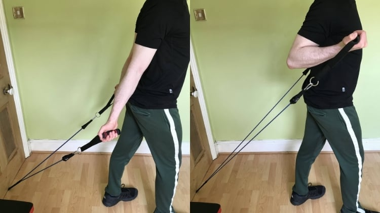A man performing a resistance band incline curl for his biceps