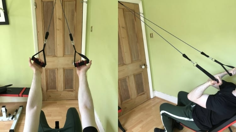 A man doing resistance band incline curls