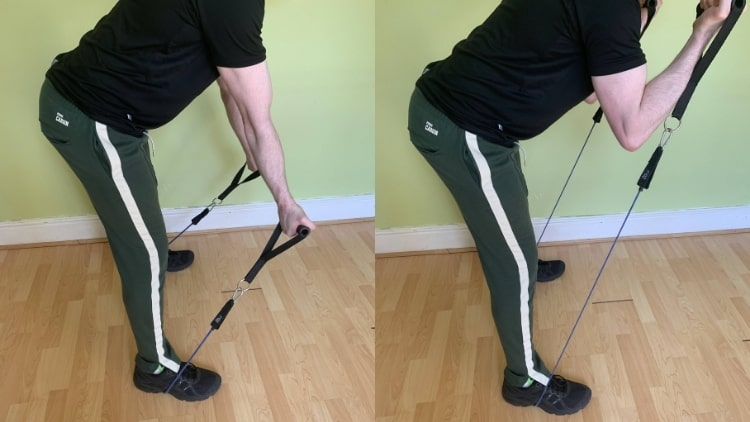 A man doing a resistance band spider curl