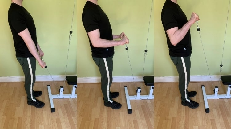 A man demonstrating how to do a reverse cable curl