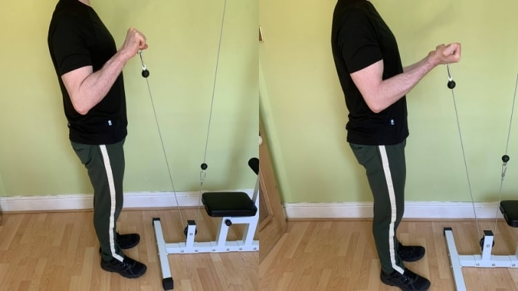 A man demonstrating the difference between a reverse curl and a bicep curl
