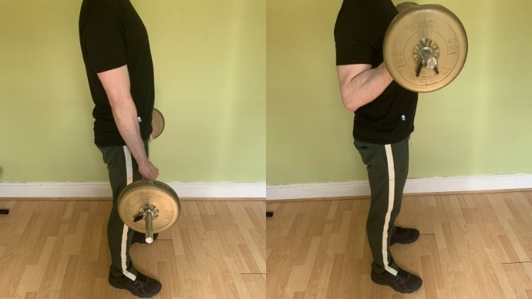 Man performing reverse curls with a barbell