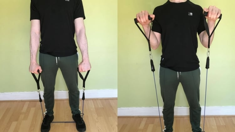 A man performing reverse curls with resistance bands