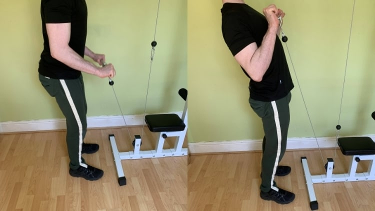A man using too much momentum during the reverse grip cable curl