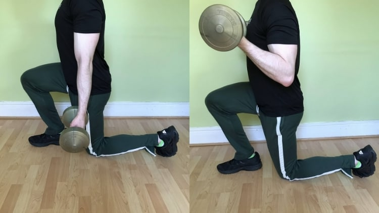 Man performing reverse lunge curls for his biceps