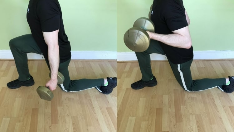 Man doing a reverse lunge with bicep curl