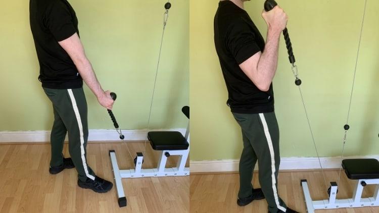 Man performing rope curls for his biceps