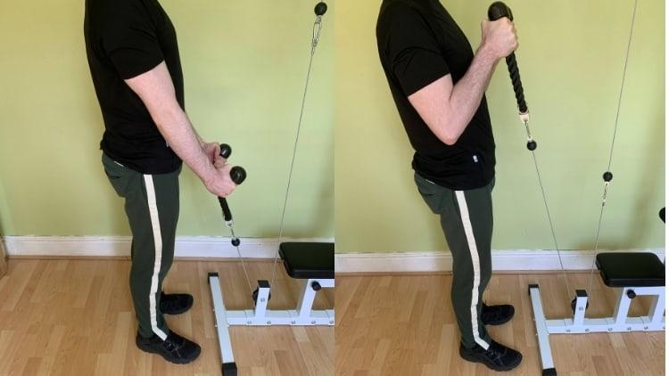 Man performing rope hammer curls for his biceps