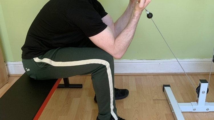 Man doing a seated cable curl for his biceps