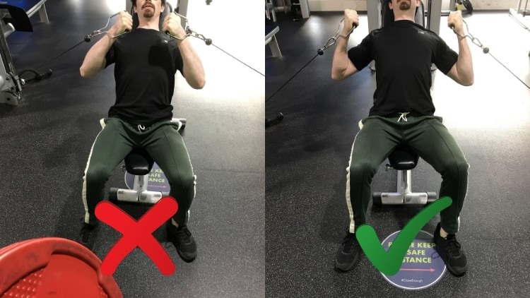 A man performing a seated incline cable bicep curl