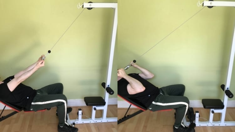 A man performing a seated incline cable curl