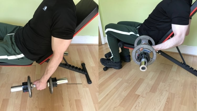 Man performing seated incline curls for his biceps with dumbbells