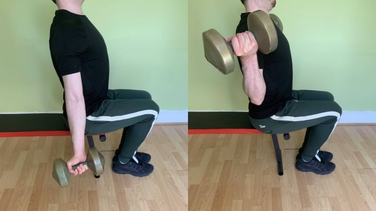 Man doing seated wide dumbbell curls