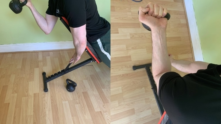 Man performing a one arm kettlebell spider curl