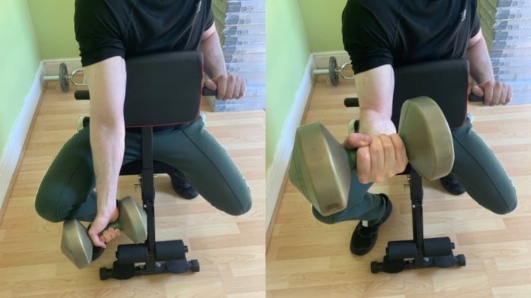 Man performing a single arm preacher curl for his biceps