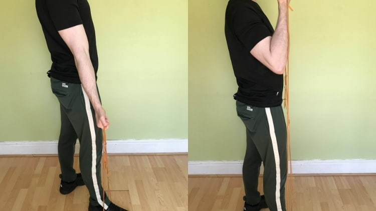 Man performing a single arm resistance band bicep curl