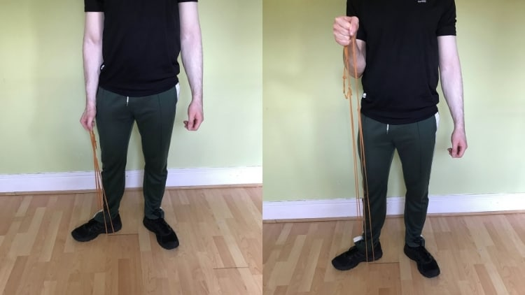 Man performing a single arm resistance band hammer curl