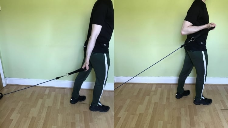 Man performing a one arm resistance band incline curl