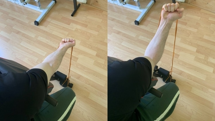 A man performing a single arm resistance band preacher curl