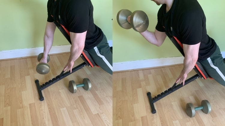 A man performing a one arm reverse spider curl