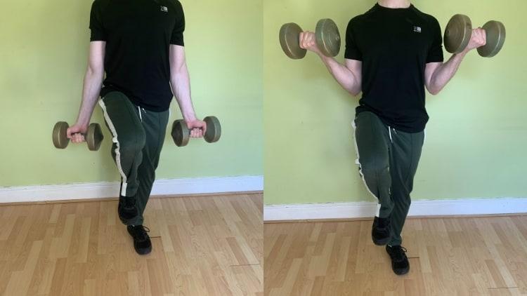 Man doing a single leg bicep curl