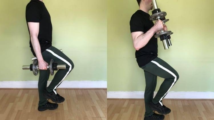 A man performing single leg dumbbell hammer curls