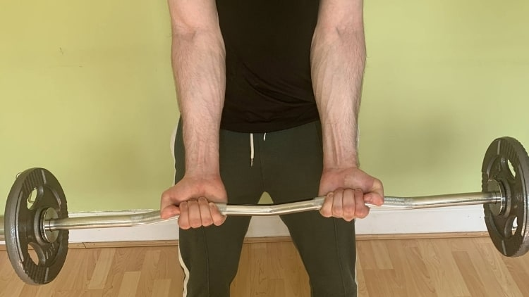 A man doing a sissy curl exercise
