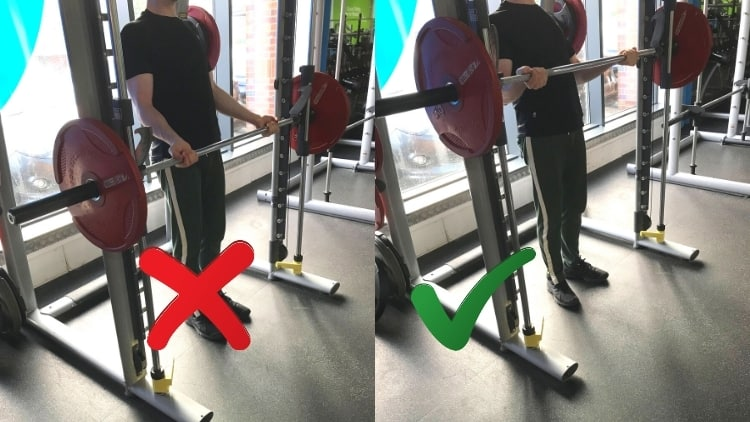 A man making a common Smith machine curl mistake; performing half reps