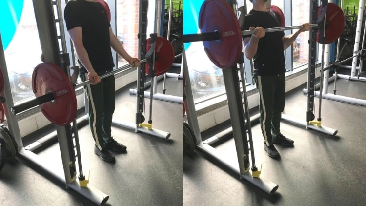 A man performing Smith machine curls for his biceps