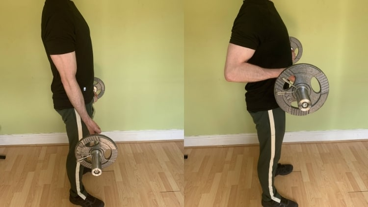 A man performing a popular spider curl replacement exercise