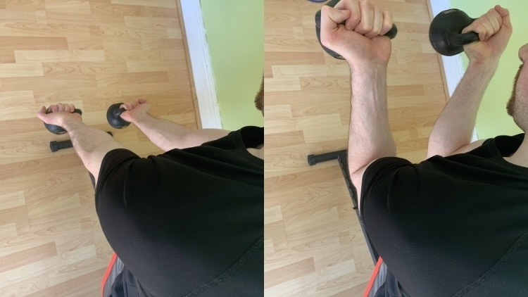 Man performing a spider kettlebell curl for his biceps