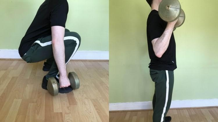 A man performing a squat bicep curl