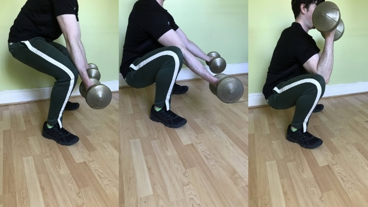 A man performing a squat with bicep curl