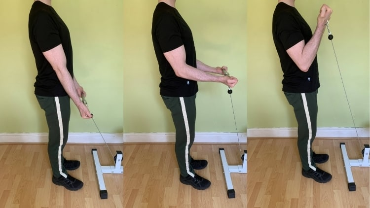 Man doing standing bicep cable curls
