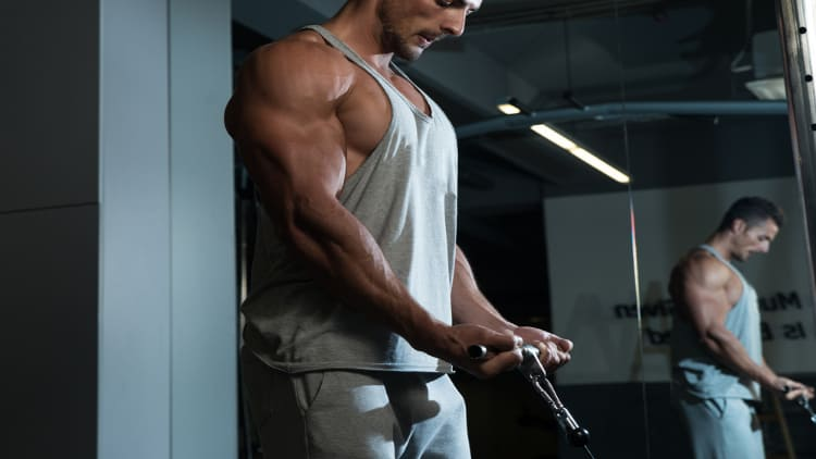 Man doing low cable curls