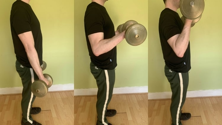 Man performing a standing dumbbell reverse curl