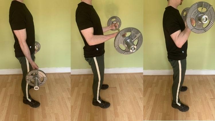 A man doing a standing EZ bar biceps curl