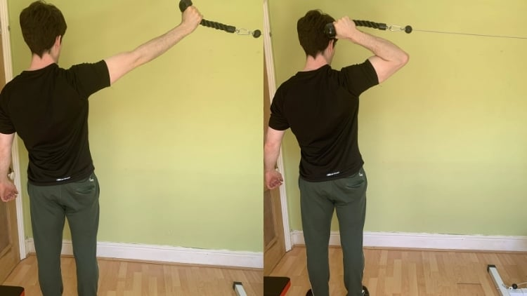 Man performing a standing high pulley cable curl
