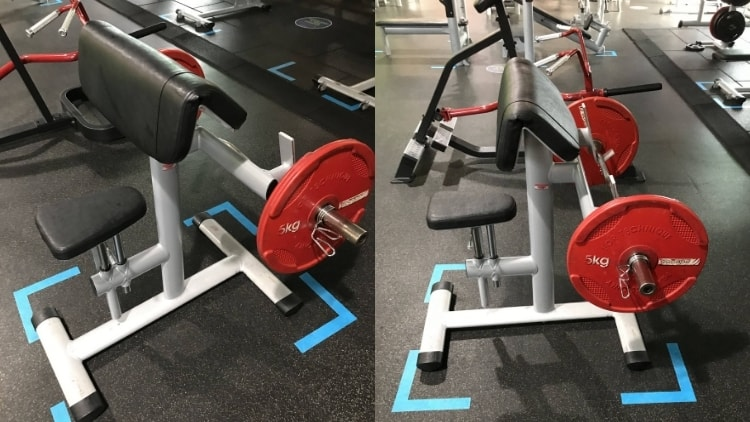The bench and barbell used during the standing preacher curl