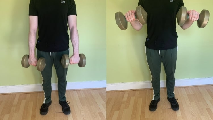 Man performing a standing reverse dumbbell curl