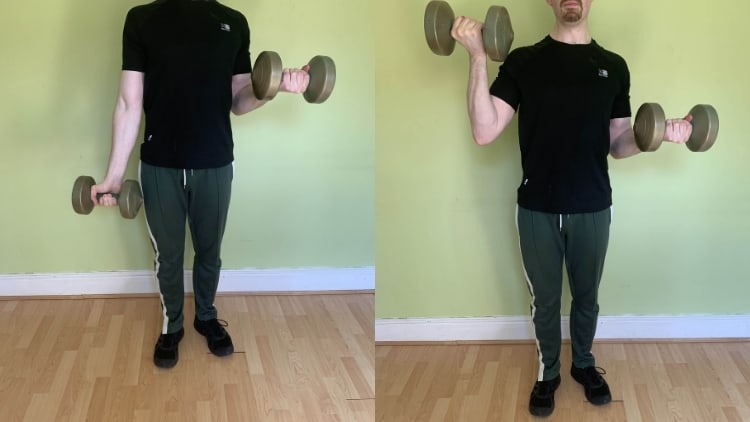A man performing static arm curls for his biceps