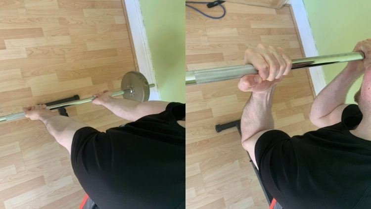 A man performing straight bar spider curls for his biceps