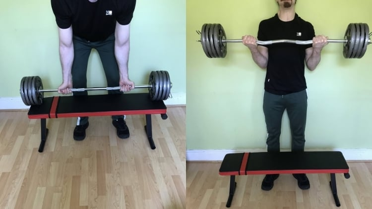 A man performing a heavy strict curl according to the rules