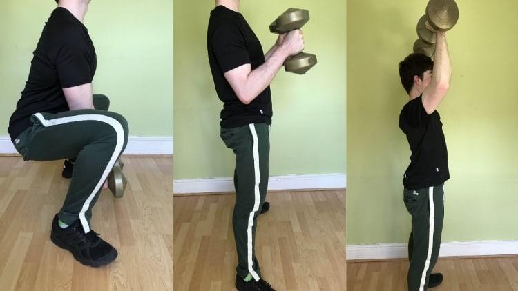 Man doing a sumo squat curl press