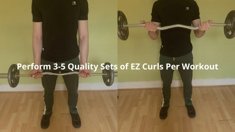 A man performing a supinated EZ bar curl
