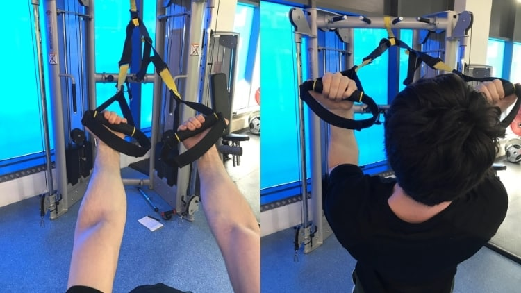 A man performing a TRX biceps curl