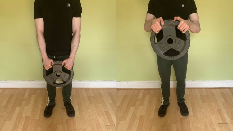 Man performing a weight plate reverse curl