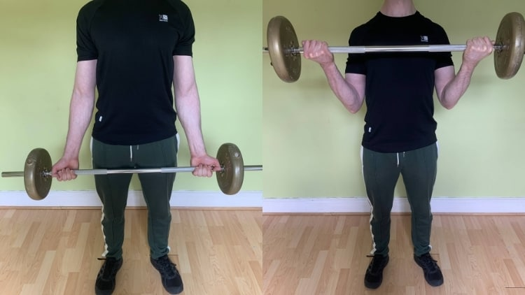 A man performing wide grip barbell curls for his biceps
