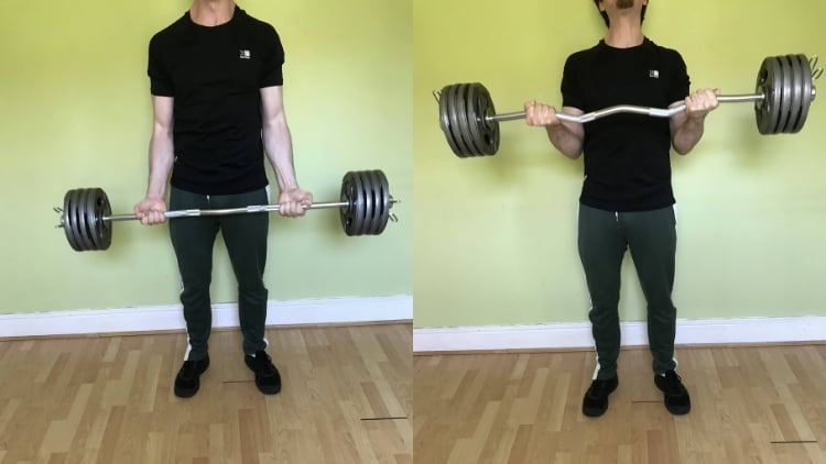 A man performing wide grip bicep curls with an EZ bar