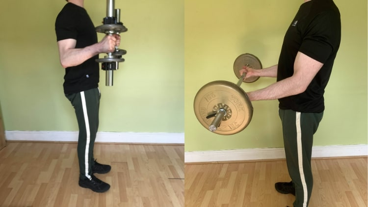 A man demonstrating some bicep workouts for beginners to build muscle.